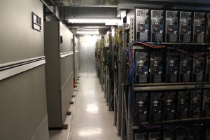 A hallway in our West Coast Data Center full of Dedicated Server towers.