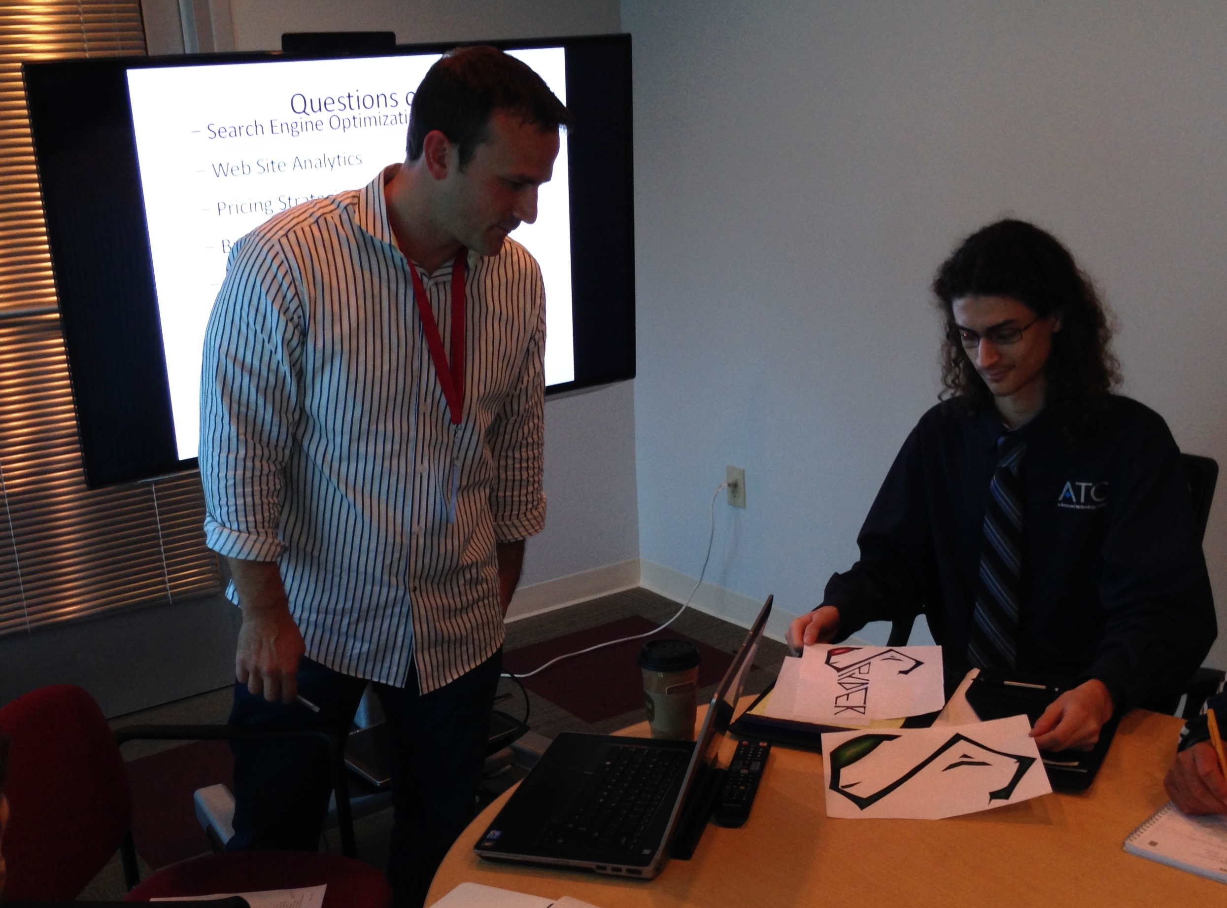 Spyder Web & Design team member getting input on logo design.