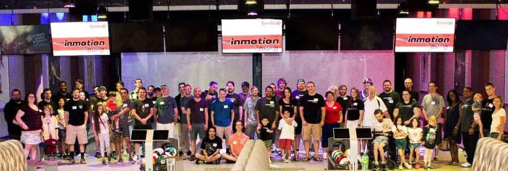 Colorado team members pose for picture at annual summer event