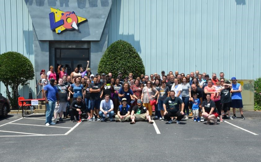 Virgina Beach team members pose for picture at annual summer event